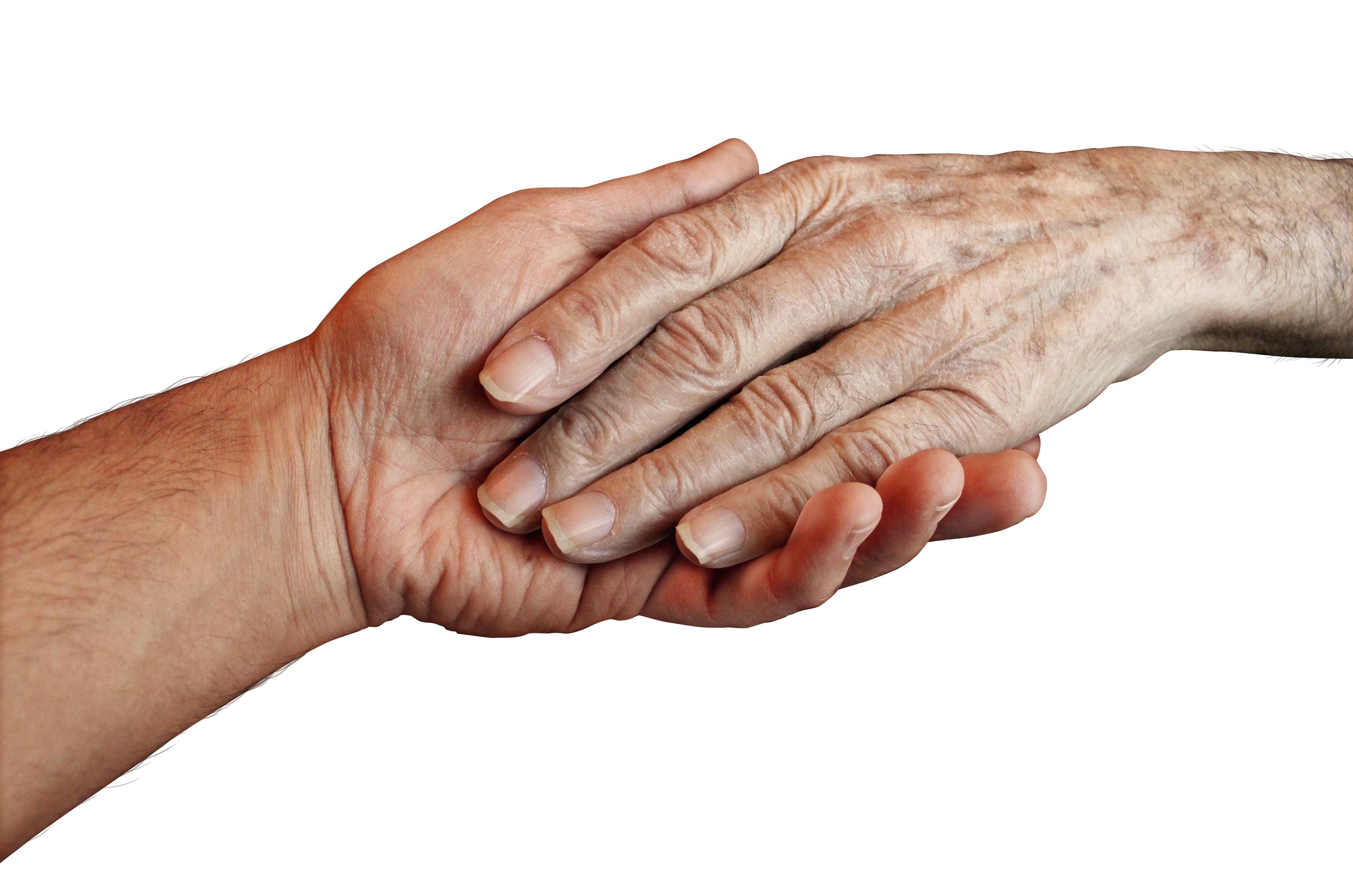 een hand ligt in een andere hand